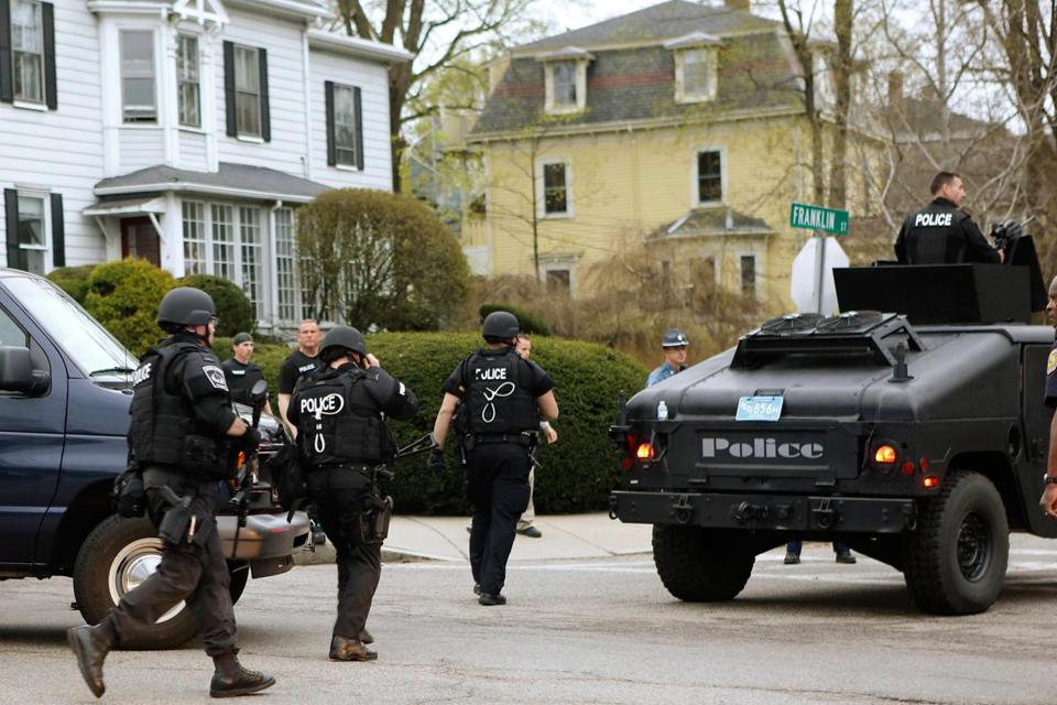 SWAT officers rushed toward a Watertown house in the search for alleged Marathon bomber Dzhokhar Tsarnaev in April.