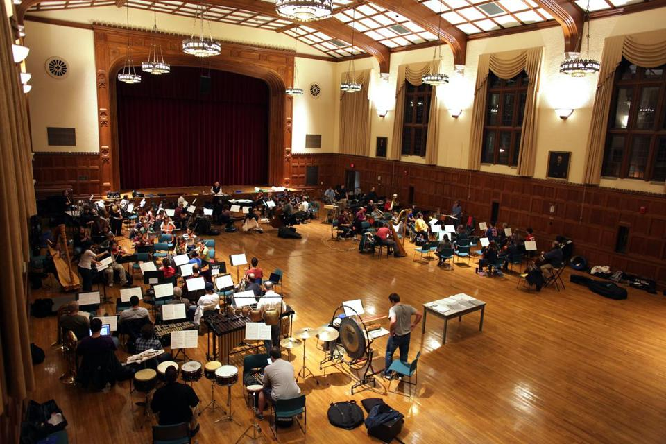 The three orchestras set up in a horseshoe shape to rehearse at WPI.