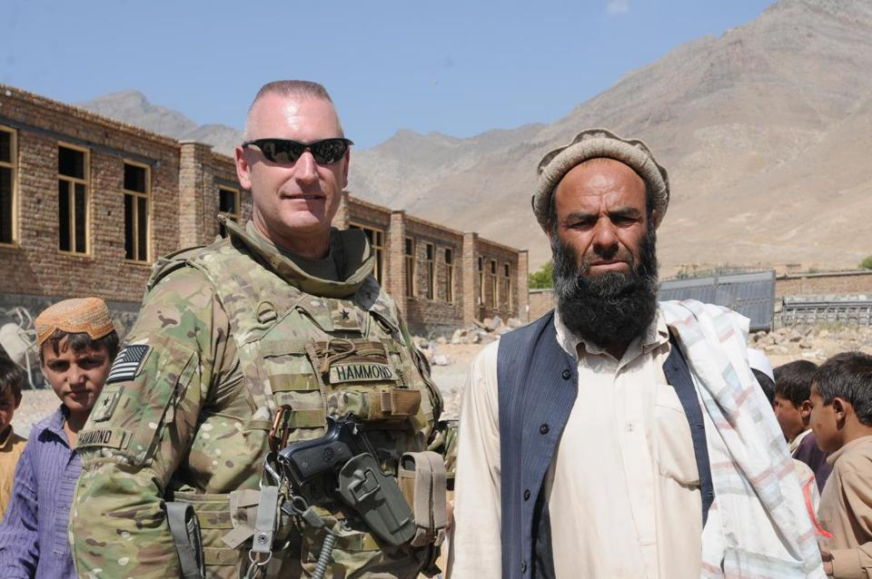 Jack Hammond, retired Army brigadier general, with a village elder in Kabul province in Afghanistan in 2011. says the Marathon bombing left him with sleepless nights.