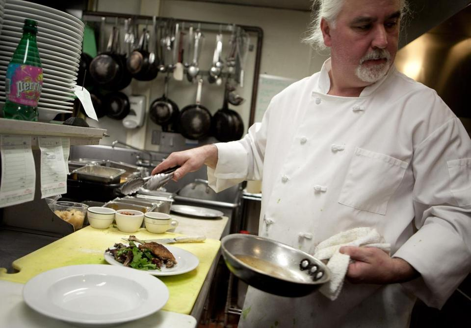 Chef Chris Scanlon cooks in the kitchen of the Oregon Club restaurant.