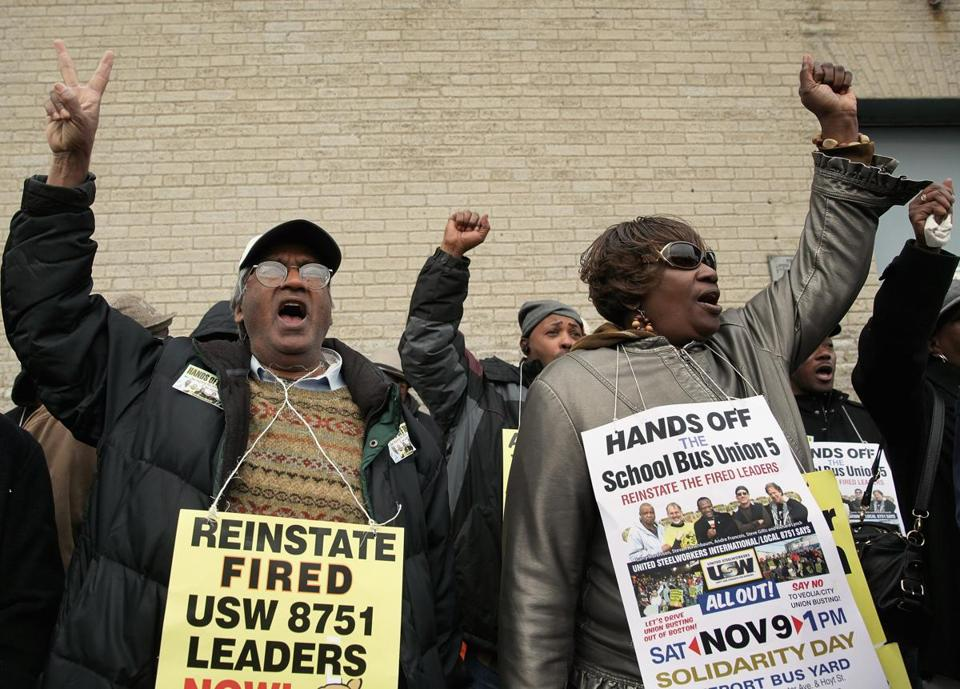Boston, MA 110913 Shahide Comrad (cq), left, and Boston bus driver Marion Major (cq) were among many who attended a Dorchester rally in support of Boston School bus drivers, Saturday, November 9 2013. (Globe Staff/Wendy Maeda) section: Metro slug: 10busdrivers reporter: