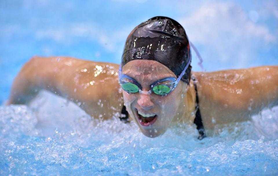 Brockton High senior Virginia Burns successfully defended her title at the Nov. 9 MIAA girls South Sectional swim meet at Massachusetts Institute of Technology, where she broke her own record in the 100 butterfly with a time of 56.58.