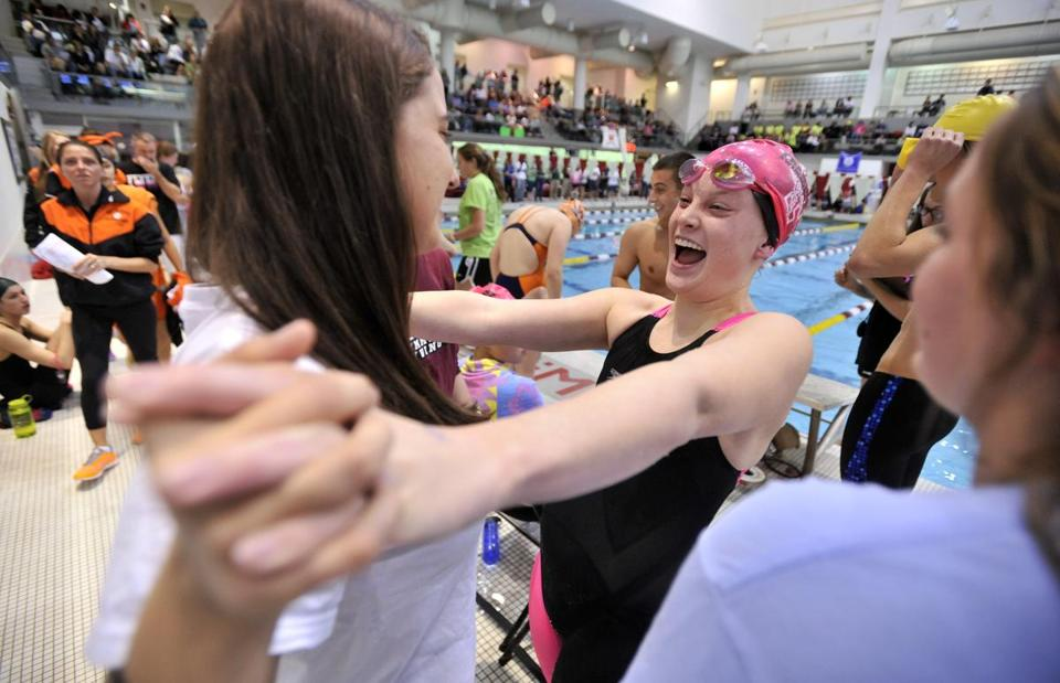 Framingham's Maddie Biron (center) celebrates her team's win in the 200 freestyle relay at the MIAA's South sectional championships last week.