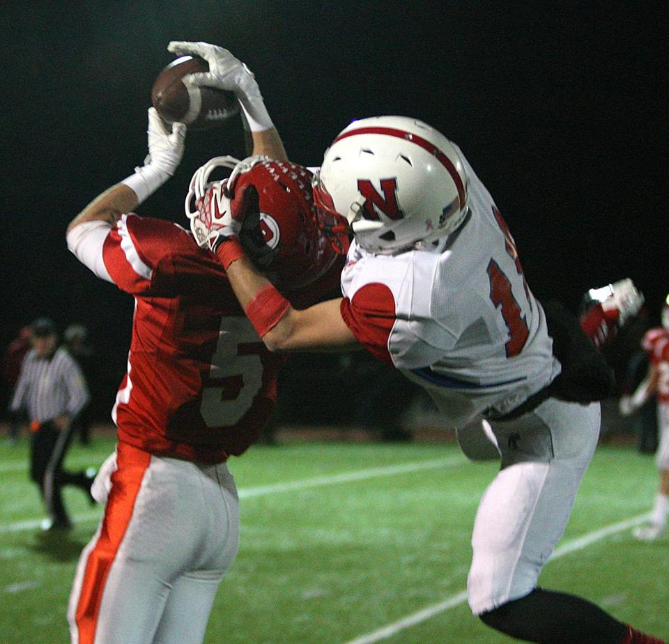 Barnstable's Colby Blaze beats Natick's Andrew Boynton to the ball, one of two Barnstable interceptions of Troy Flutie.