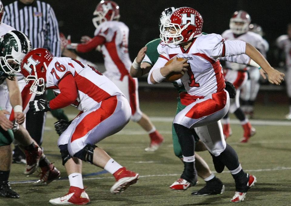 Holliston QB Matt Jeye looked for running room behind lineman 76 Mark Mulvaney.