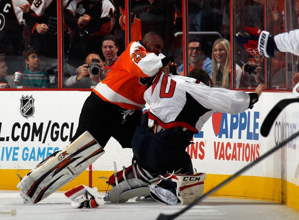 Flyers goalie Ray Emery (left) went after Capitals goalie Braden Holtby during a Nov. 1 game in Philadelphia. The Capitals won, 7-0.
