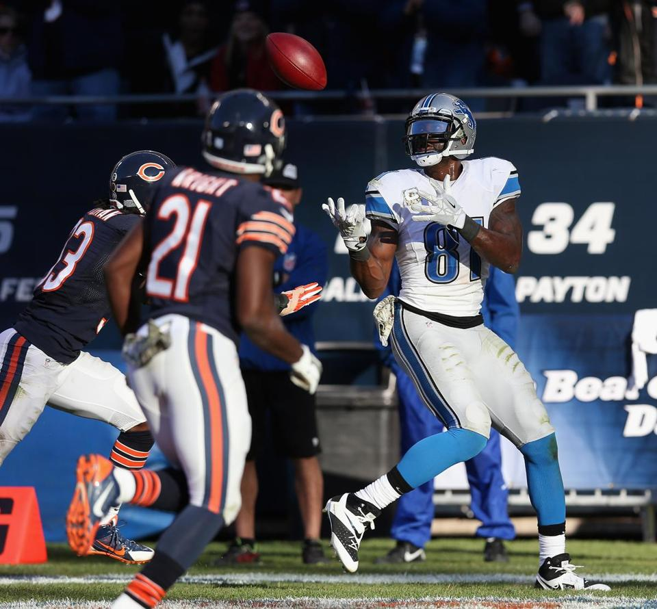Calvin Johnson gets behind Bears Charles Tillman and Major Wright for the winning TD.