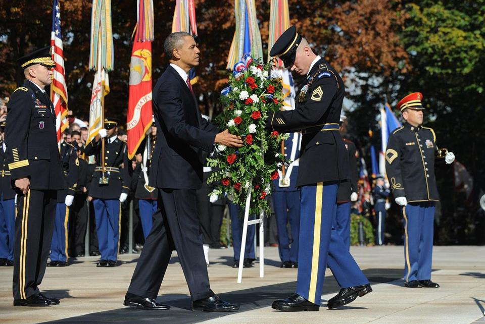 President Obama paid tribute to America's veterans by laying a wreath at Arlington National Cemetery.