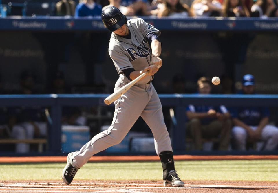 Wil Myers hits an RBI single against the Blue Jays in Toronto Sept. 28.