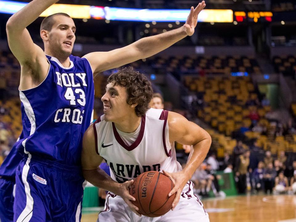 Harvard's Jonah Travis, who scored 20 points, gets Holy Cross big man Taylor Abt to bite on this second-half deke.