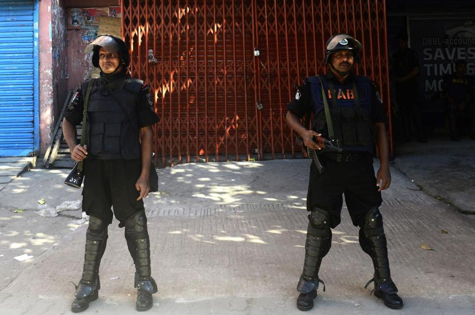 Bangladeshi Rapid Action Battalion personnel stood guard during a nationwide strike in Dhaka on Sunday.