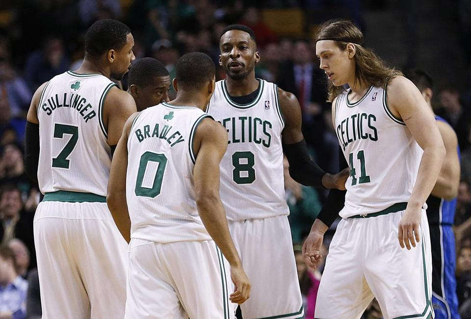 Jeff Green (8) assembles a fourth-quarter huddle with his Celtics teammates, who have really come together of late.