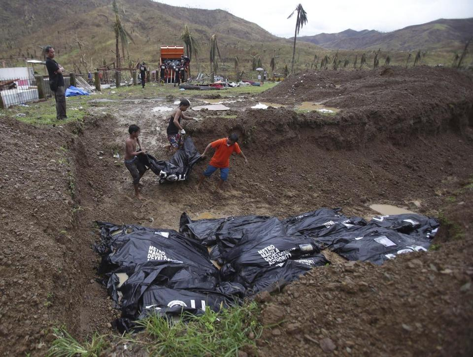 Burials began Thursday in Tacloban, six days after the typhoon. The mayor blamed the national government for the delay.