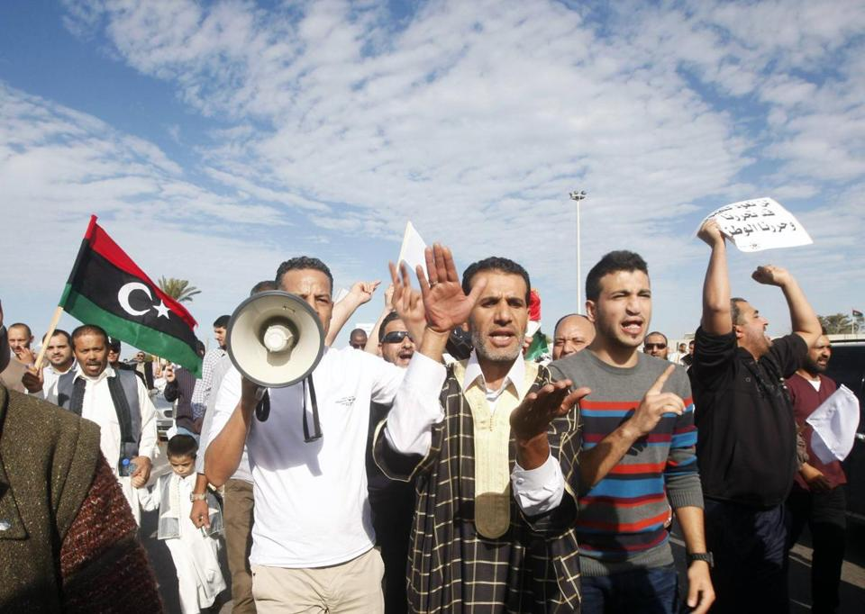 Protesters marched during a demonstration calling on militiamen to leave in Tripoli November 15, 2013.