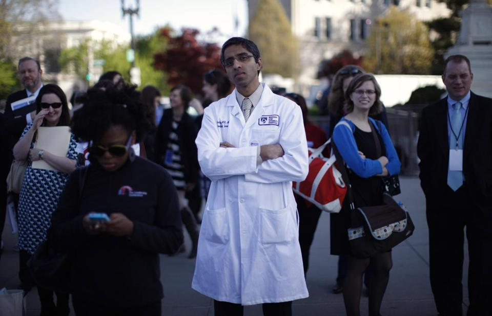 Dr. Vivek Murthy stood among other bystanders during the first day of legal arguments over the Affordable Care Act outside the Supreme Court in 2012.