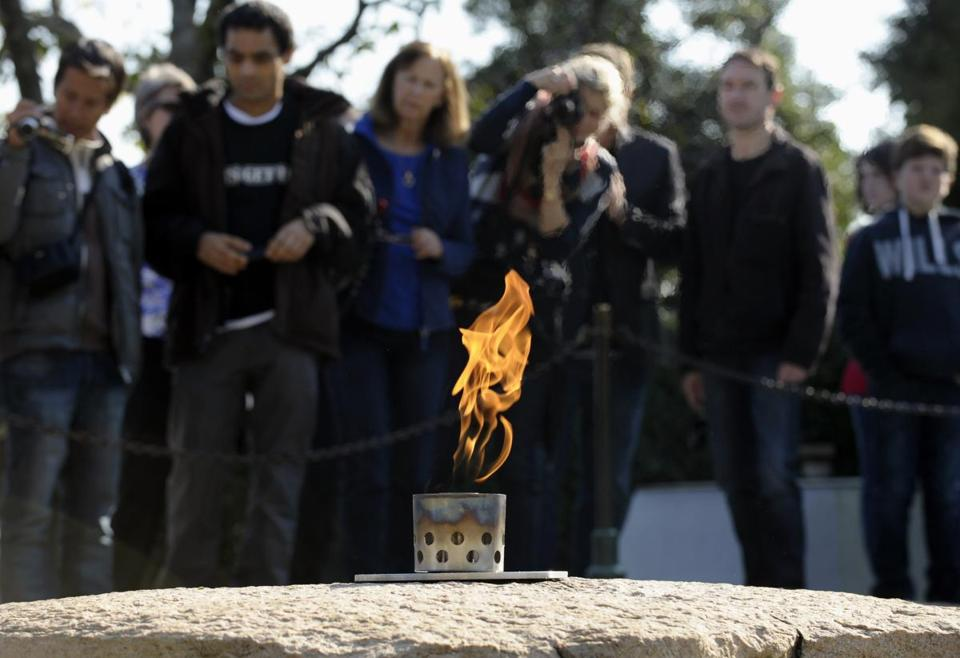 Visitors stood near the eternal flame at the gravesite of John F. Kennedy.