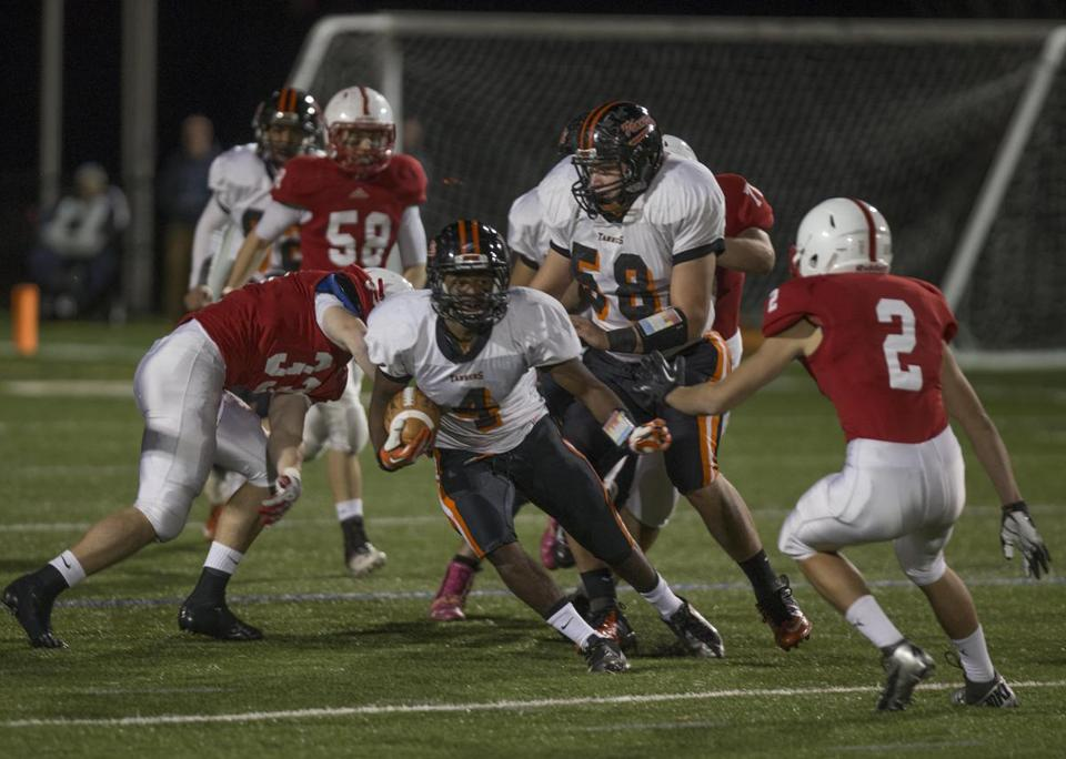 Marvin Jean (4) and his Woburn teammates were continually bottled up by an aggressive Melrose defense.