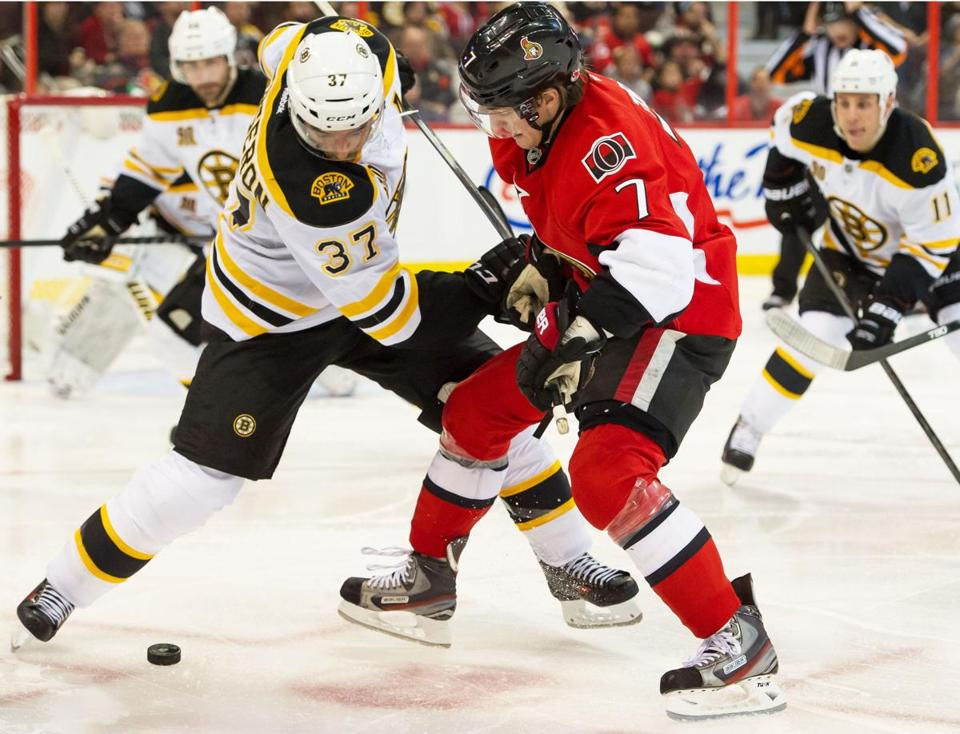 The Bruins' Patrice Bergeron and the Senators' Kyle Turris faced off in the second period.