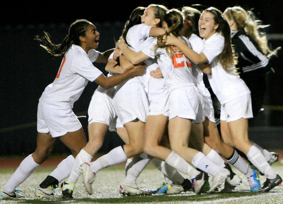 It was a team effort when Newton North got to celebrate its state championship.