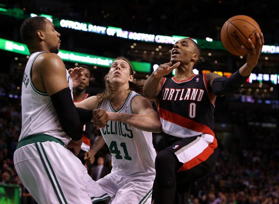 Celtics big men Jared Sullinger (left) and Kelly Olynyk appeared helpless in attempting to stop Trail Blazers guard Damian Lillard on a second-half drive.