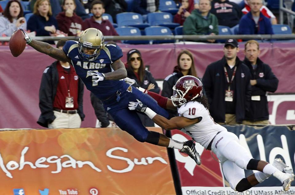 Akron's Jawon Chisholm leaped for a touchdown as Devin Brown tried to prevent the score.