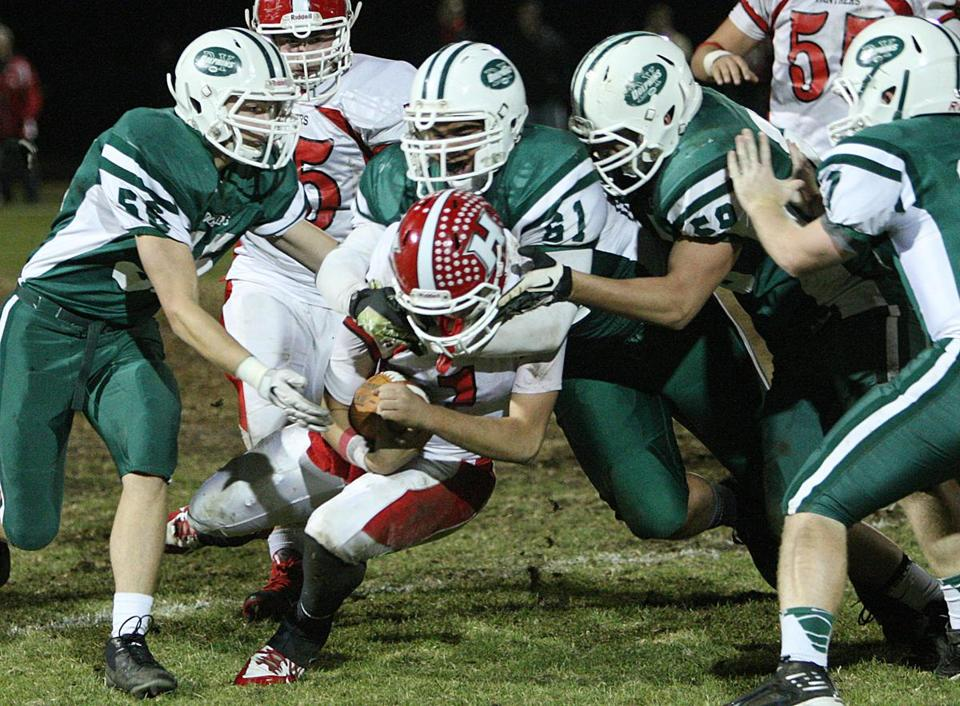 The Dennis-Yarmouth offense wasn't clicking, but its defense picked up the slack; just ask Holliston QB Matthew Jeye.