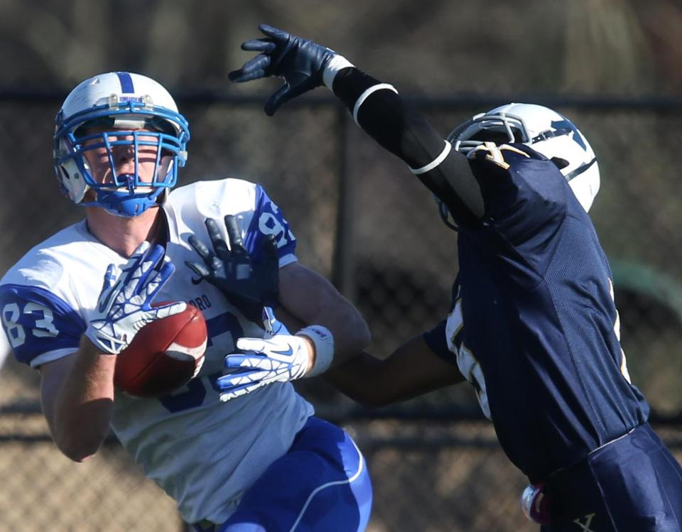 Attleboro's Luke Morrison corralled this pass for a TD over Mekhi Henderson, but Xaverian hung on for the win.