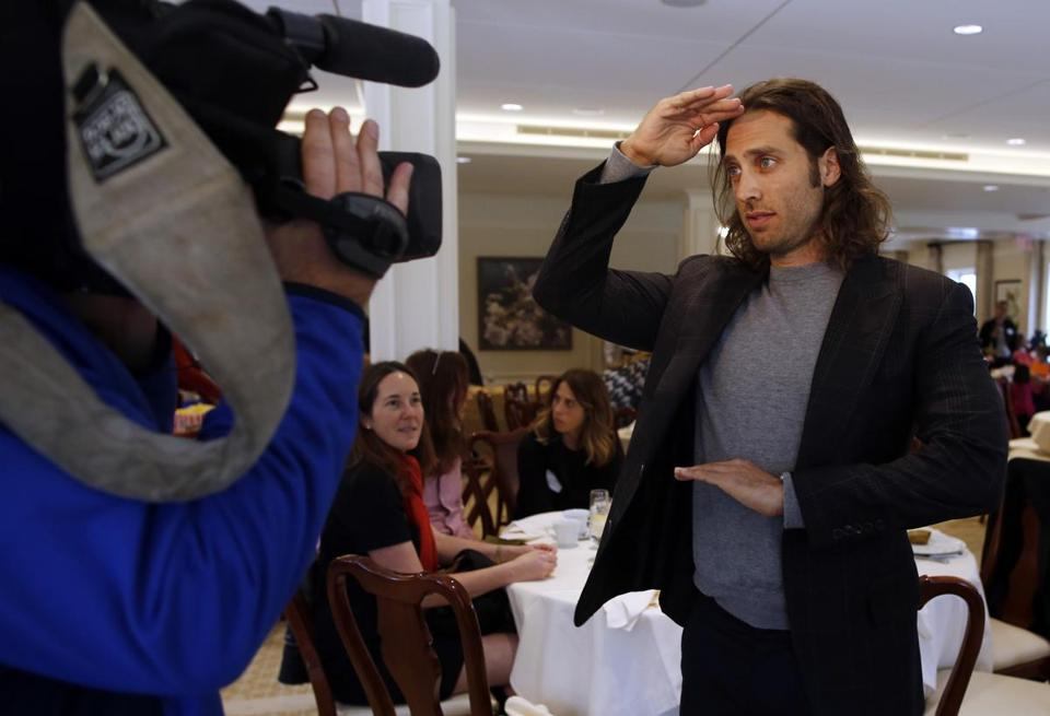 "Newton native and ""Glee"" co-creator Brad Falchuk gestured to a videographer before an appearance last fall at the Woodland Golf Club in Auburndale on behalf of his brother, Evan, who is running for governor."