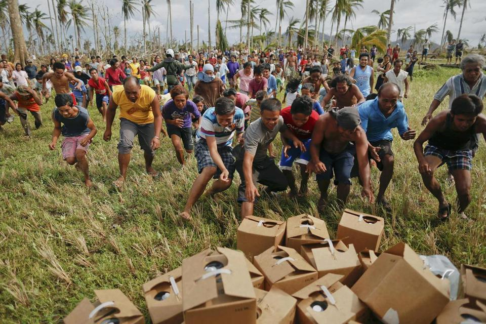Typhoon survivors in an isolated village north of Tacloban rushed for water supplies delivered by a US military helicopter on Sunday.