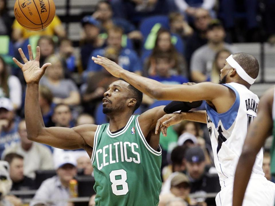 Jeff Green reaches for a pass as Minnesota's Corey Brewer attacks on defense.