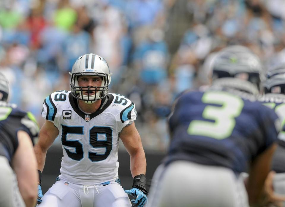 Luke Kuechly (59) kept quiet and learned during a fine rookie season, for which he was named Defensive Rookie of the Year, and he's been playing well again this year for Carolina.