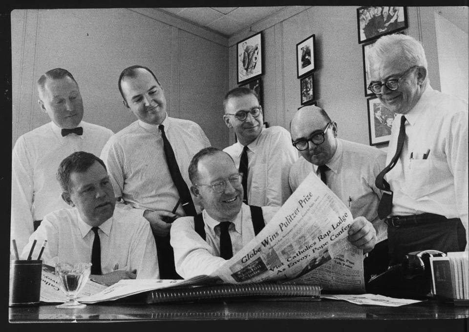 Celebrating the Boston Globe's first Pulitzer Prize in 1966 were, from left (front row):  Bob Healy, Washington bureau chief, Tom Winship, editor; (back row) reporters Joseph M Harvey, Martin Nolan, Anson 'Bud' Smith, Richard Connolly, and editorial page editor Charles Whipple.