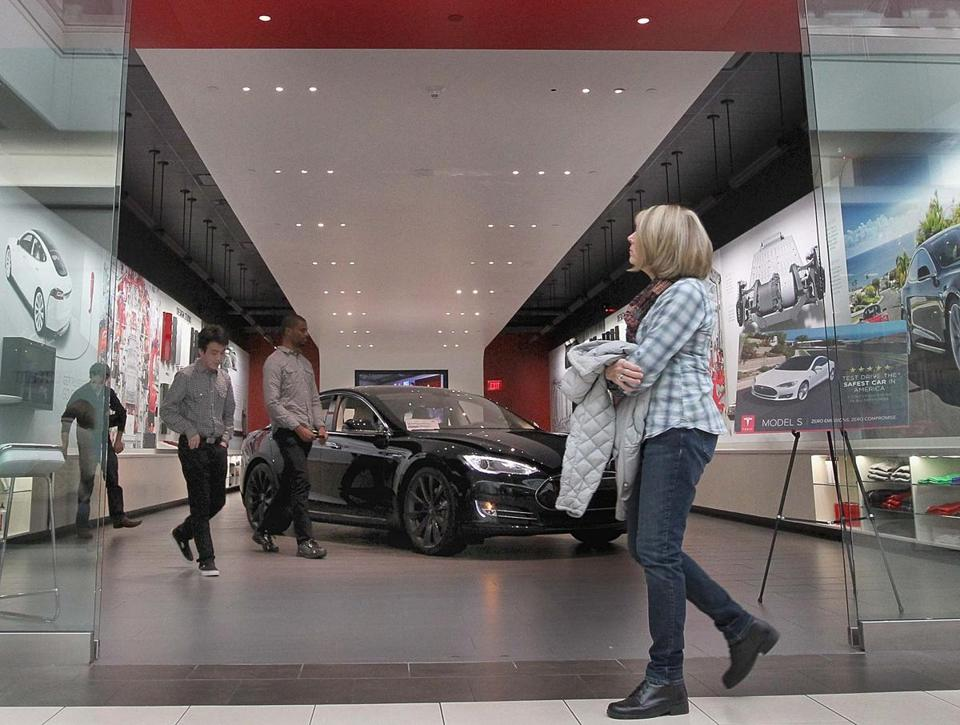 The Tesla showroom at the Natick Mall has an electric car on display.