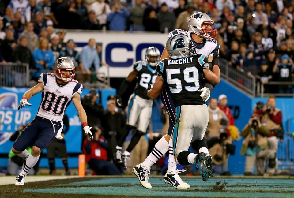 Carolina's Luke Kuechly (59) and New England's Rob Gronkowski jostled in the end zone during the final play of Monday's game.