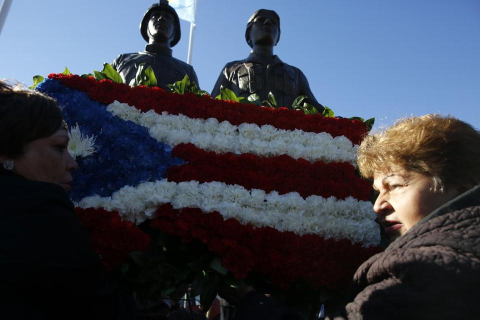Under a clear blue sky Tuesday, the city of Boston unveiled a monument to Puerto Rican veterans during a ceremony in the South End in front of a crowd of about 100. A floral wreath shaped like the Puerto Rican flag adorned the monument.