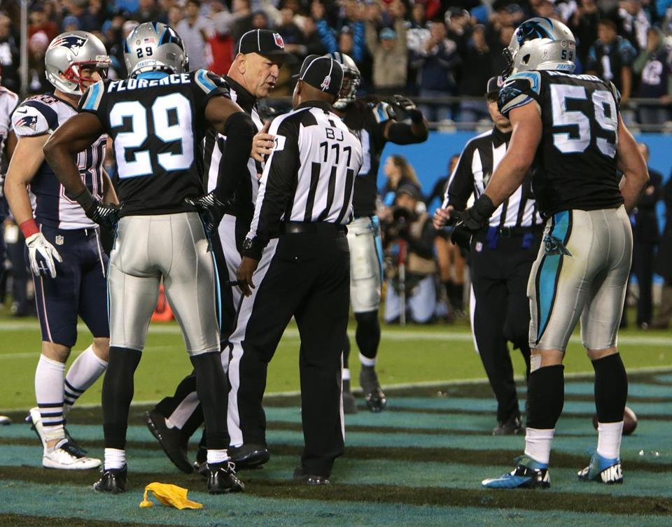 Back judge Terrence Miles (111), who threw a flag for pass interference, picked up flag after conferring with officials.