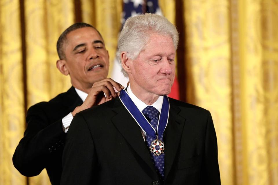 Former President Bill Clinton and Oprah Winfrey were among more than a dozen prominent Americans given the Presidential Medal of Freedom  Wednesday.