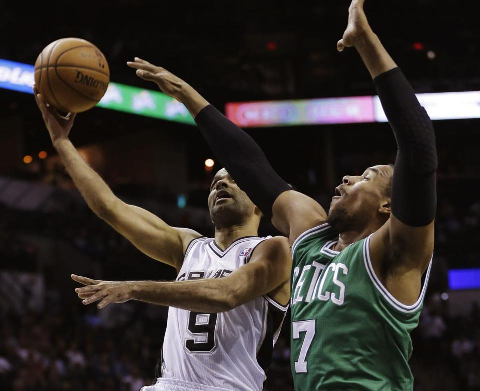The Spurs' Tony Parker took a shot over Jared Sullinger in the first half.