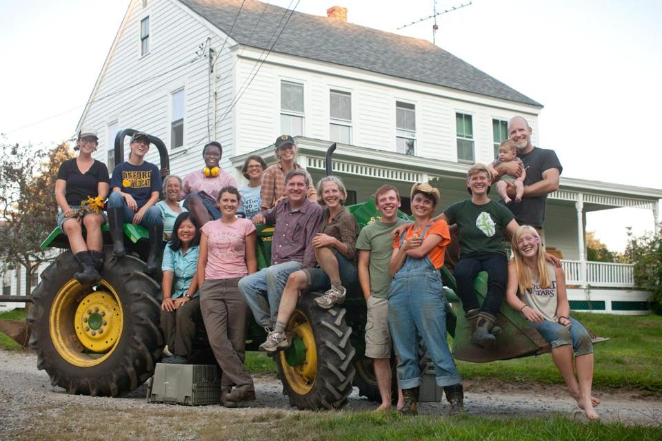 Erik Jacobs and his son, Wendell (top right), with the class of 2013 Farm School in Orange.