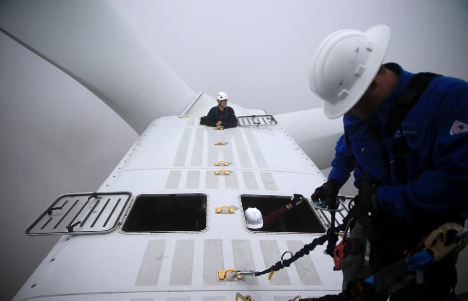 First Wind employees worked at a turbine at the Bull Hill Wind Farm in Lincoln, Maine.