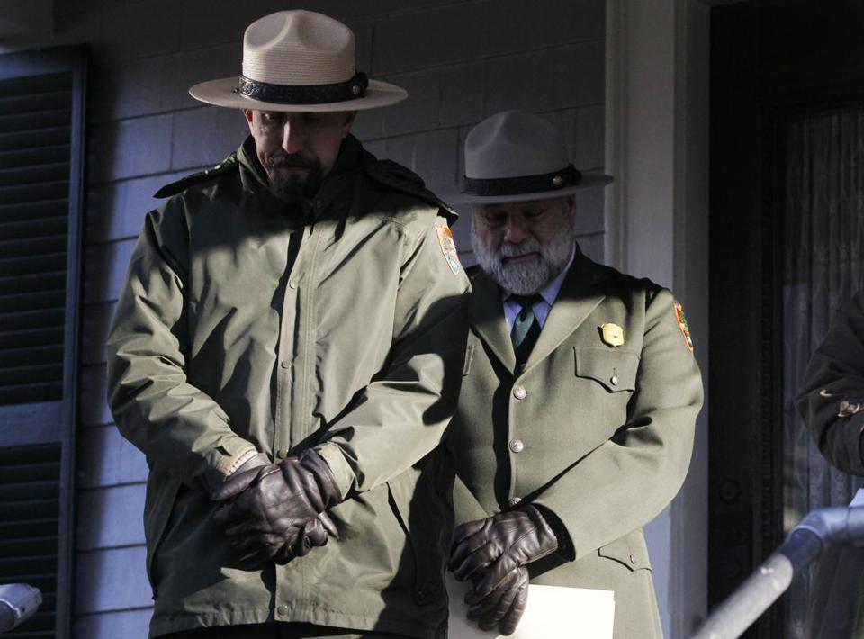 National Parks Service members, including Jim Roberts (right), bowed their heads in prayer during a ceremony Sunday at John F. Kennedy's birthplace in Brookline.