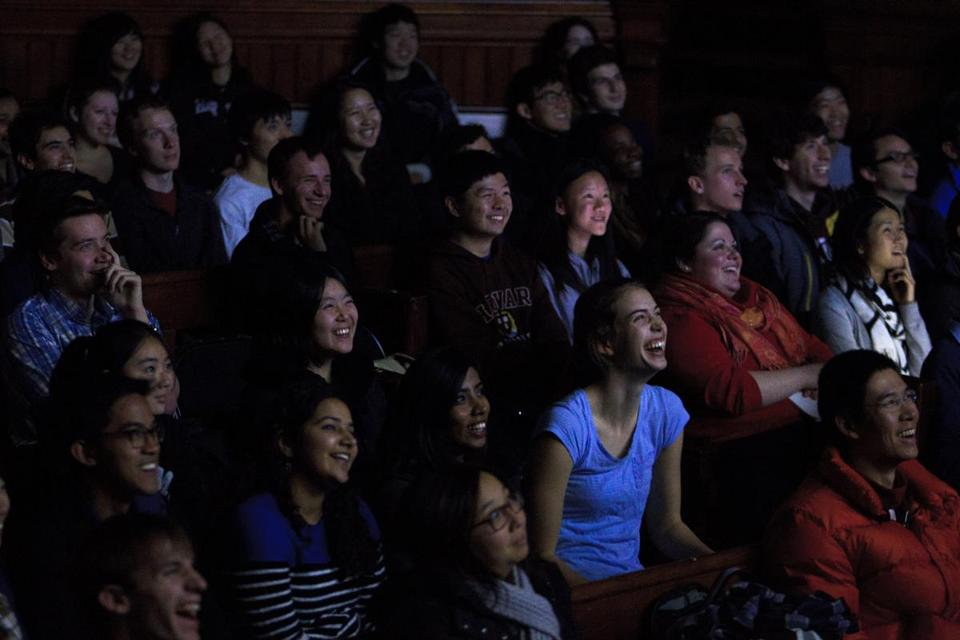 Students fill Sanders Theatre at Harvard for the popular introductory computer science class, CS50.