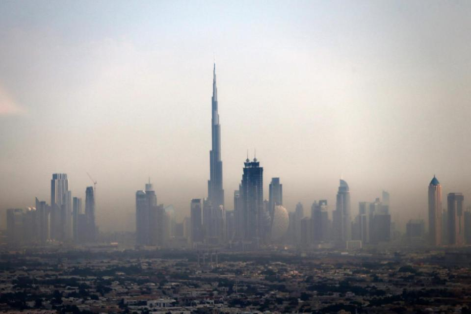 Burj Khalifa soars above the other buildings in Dubai.