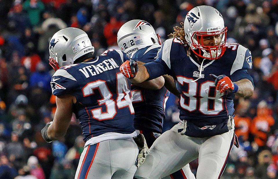 Brandon Bolden, right, celebrated with Shane Vereen and Stevan Ridley after his third-quarter touchdown.
