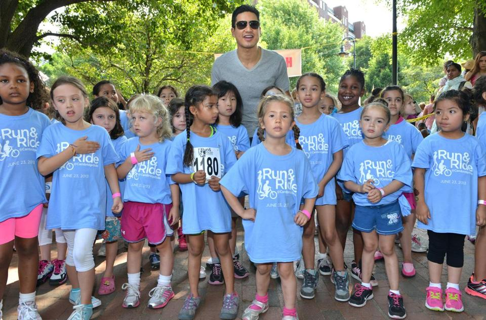 Mario Lopez stood with young runners at the start of the Run & Ride at CambridgeSide.