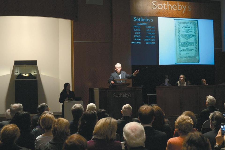 Auctioneer David Redden discussed the book during the sale in New York on Tuesday. It was sold at a one-lot auction by Sotheby's.