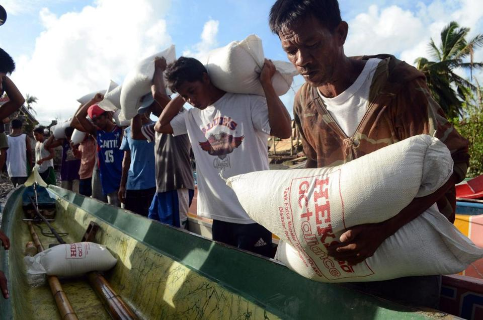 Victims of Typhoon Haiyan loaded up sacks of rice in the town of Pilar on Panay Island.