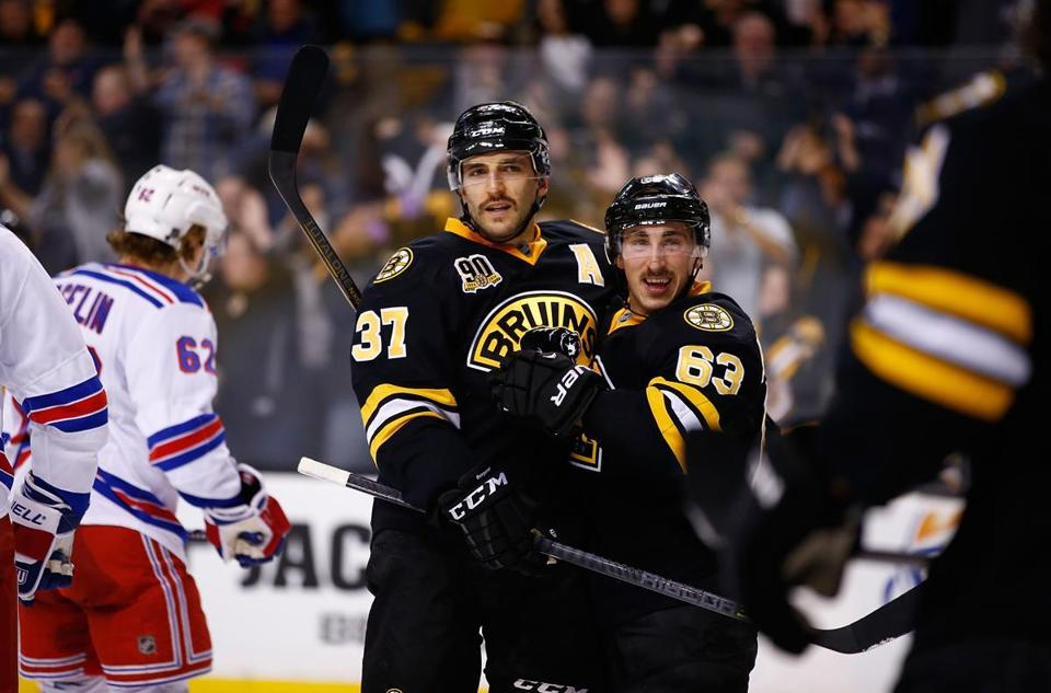 Brad Marchand (right) celebrated with Patrice Bergeron after Bergeron scored in the third period.