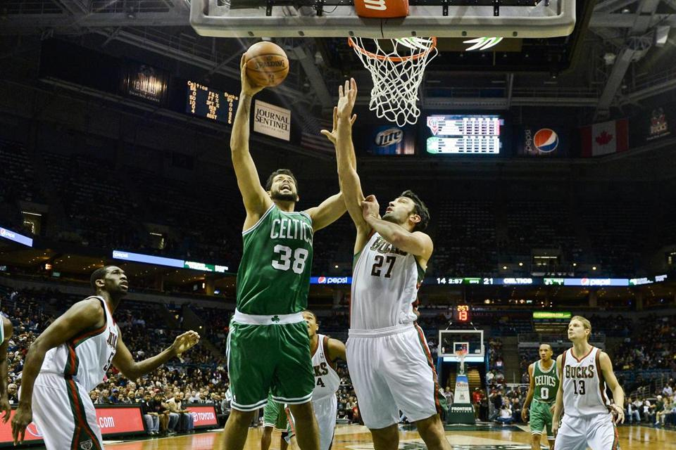 Celtics center Vitor Faverani drives to the basket in the first half against the Bucks.