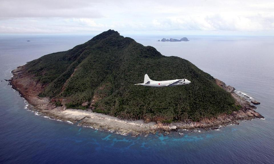A Japanese patrol plane flies over the disputed islands in the East China Sea in 2011.